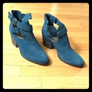 Blue booties with side cutouts.